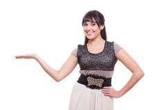 Smiley young woman holding something on her palm Royalty Free Stock Photography