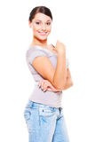 Smiley young woman in jeans Royalty Free Stock Images