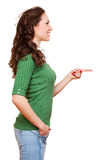 Smiley young woman pointing at something Royalty Free Stock Photography