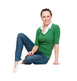 Smiley young woman sitting Stock Image