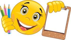 Smiley z drewnianym schowkiem i barwionymi ołówkami Zdjęcia Royalty Free