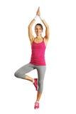 Smiley zdrowa młoda kobieta robi joga Obrazy Stock