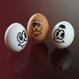 Smileyframsida för tre ägg Arkivfoton