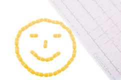 Smileyframsida och ekg Arkivfoton