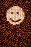 Smileyframsida som göras av kaffe Royaltyfri Bild