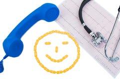 Smileyframsida, telefon och ekg Royaltyfri Foto
