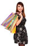 Smileyfrau mit Einkaufenbeuteln Stockfotos