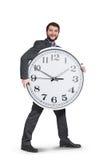 Smileygeschäftsmann mit großer Uhr Lizenzfreie Stockfotos