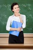 Smileylärare på blackboarden arkivbild