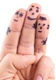 Smileys семьи покрашенные на пальцах человека Стоковые Изображения RF