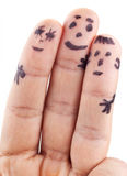 Smileys of family painted on man's fingers. Isolated on a white background stock photography