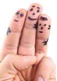 Smileys of family painted on man's fingers. Smileys of family painted on man's fingers on white background royalty free stock images