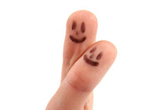 Smileys on fingertips. Isolated on white background royalty free stock photos