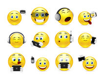 Smileys with gadgets Stock Photo