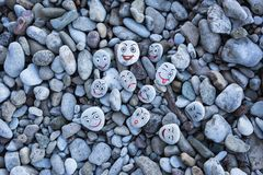 Smileys on pebbles Royalty Free Stock Image