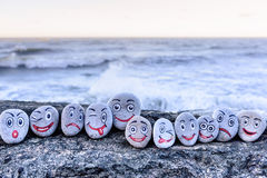 Smileys on small stones Royalty Free Stock Image