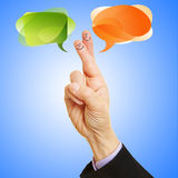 Smileys talking with speech bubbles stock images