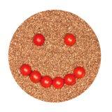 Smilie от томатов на предпосылке гроутов гречихи Стоковое Изображение