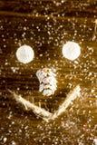 Smilie рождества сделанное с конусом шариков, веревочки и ели Стоковое Фото