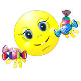 Smilie with candies. Royalty Free Stock Photography