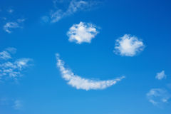 Smilie from cloud in the blue sky Stock Photography