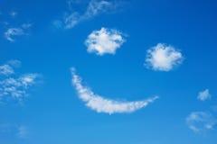 Smilie da nuvem no céu azul Fotografia de Stock