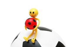 Smilie sitting on the football Royalty Free Stock Images