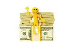 Smilie sitting on top of dollar Stock Image