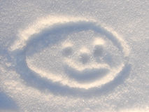 Smilie on Snow background. Smilie on snow natural blue white background outdoor Stock Photos