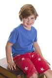 Smilie. Young boy sitting and smiling at the camera Stock Photography