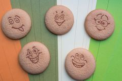 Cookies in the form of funny faces stock photography