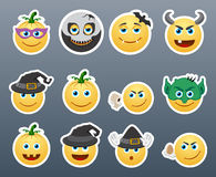 Smilies Halloween. Set of funny and very scary emoticons are dressed for Halloween Stock Image