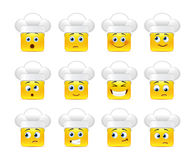 Smilies in the kitchen. Beautiful happy smiley yellow in white caps in a small set of Royalty Free Stock Image