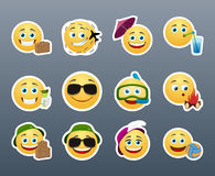 Smilies travelers. Funny and cute emoticons travelers with different things Stock Images