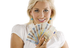 Smilig girl with cash Royalty Free Stock Images