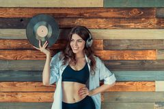 Smiliing woman indoors. Happy young woman with a phonograph record Royalty Free Stock Images