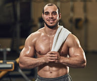 Smilimg athlete with towel Royalty Free Stock Photo