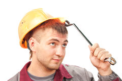 Smilimg working man with wrench Royalty Free Stock Image