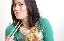 Happy Brunette Woman Smiling While Eating Sushi Stock Photography