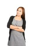 Smiline Aziatische Vrouw denken die Kijkend Exemplaarruimte Royalty-vrije Stock Fotografie