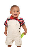 Smiling 1-year old baby boy standing holding toy Royalty Free Stock Photos