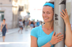 Smiling. Young and beautiful woman smiling on the street Royalty Free Stock Image
