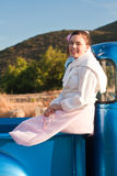 Smiling 1950s teen girl in pickup truck Royalty Free Stock Photos