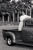 Smiling 1950s teen girl in pickup truck Royalty Free Stock Image