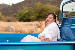 Smiling 1950s teen girl in pickup truck Stock Images