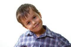 Smiling. Headshoot of a young boy smiling royalty free stock image