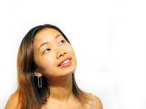 Smiling. Asian girl smiling looking up stock image