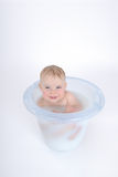 Smiling. One year old baby is taking a bath (with milk Stock Images