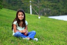 Smiling. Little girl having fun outdoors Stock Image