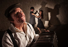 Smiling Accordion Player with Dancers Stock Images